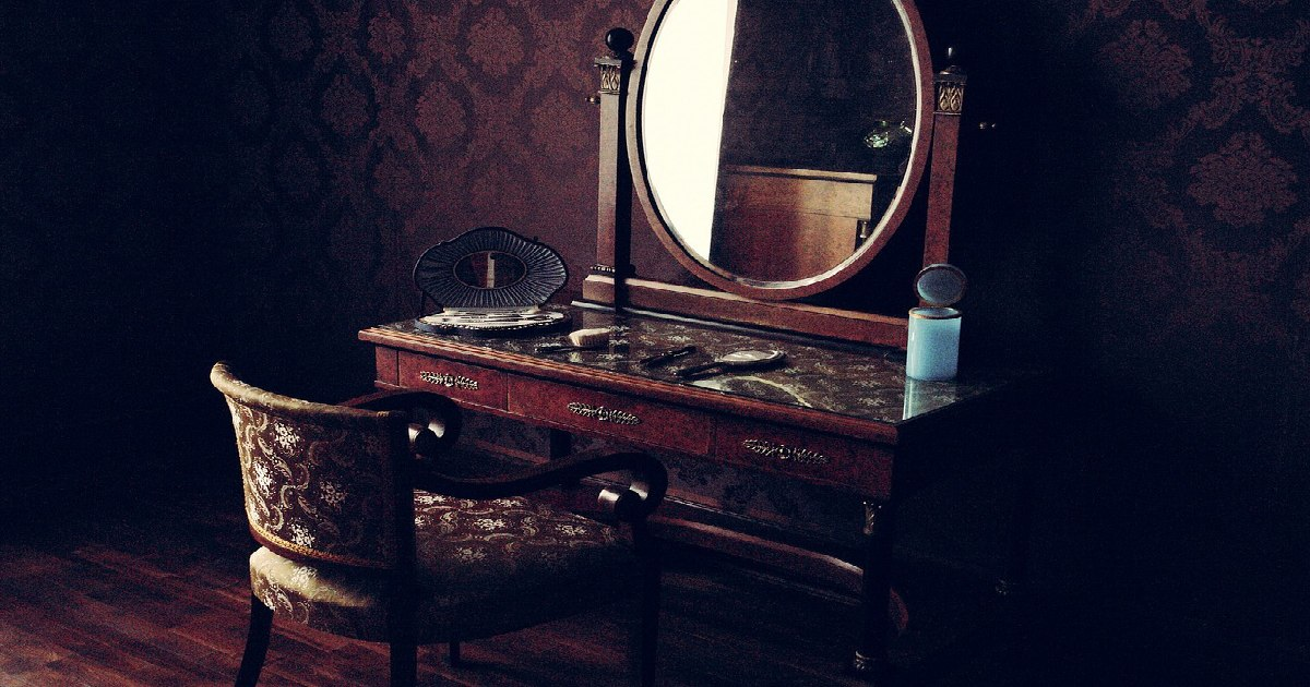 red velvet chair with old mirror